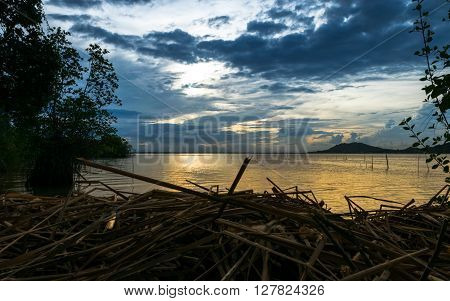 The Sunset in Songkhla Lake Thailand had dry grass in foreground