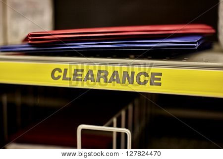 Red and blue folders on a clearance shelf in a retail store