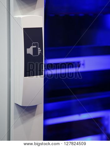 Card terminal access doors on a blue background lighting