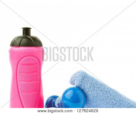 Pair of Blue Plastic coated dumbells, pink water bottle and  towel isolated over the white background