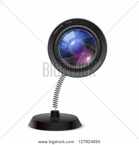 Table souvenir in form of photo camera lens on spring