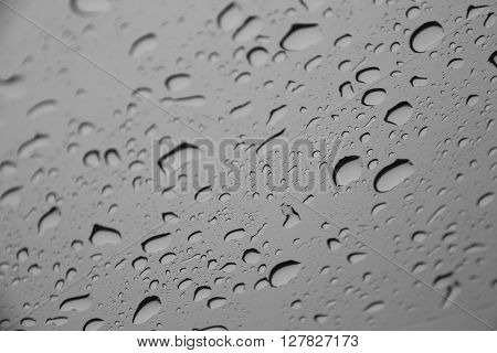 Waterdrops or raindrops on a glass surface (Selective focus)