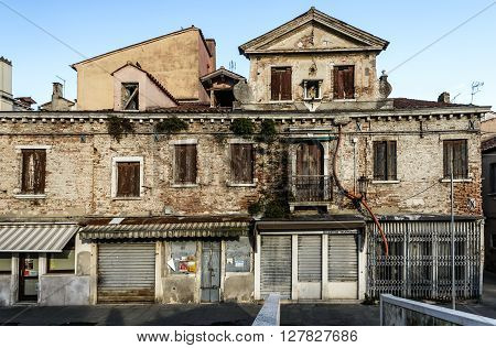 Abandoned renaissance building in old city of Chioggia,  Italy