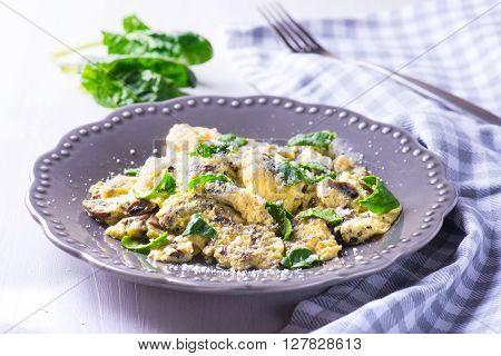 Fresh Spinach mushroom frittata on wooden table