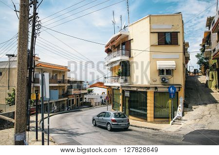 THESSALONIKI, GREECE - MAY 27, 2015: Small houses with sea view in the upper part of the city of Thessaloniki. Steep streets and crossroads on the hill.