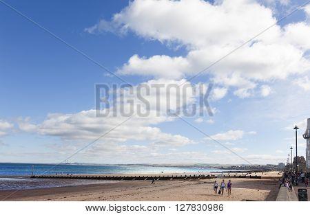 EDINBURG-SEPTEMBER 22 2013: On sunny days the people of Edinburgh take the opportunity to stroll along Portobello Beach on september 22, 2013