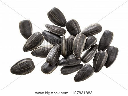 Black sunflower seeds isolated on white background. Pile of sunflower seeds isolated.