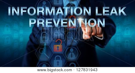 Administrator pushing INFORMATION LEAK PREVENTION on an interactive touch screen display. Information technology concept and IT risk metaphor for the detection and blocking of data leakage incidents.
