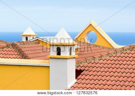 Yellow triangular or circular roof. Modern  roof architecture, Spain.