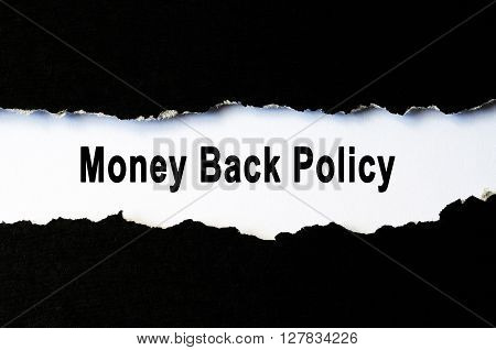 Insurance policy concept - Money back policy under torn paper