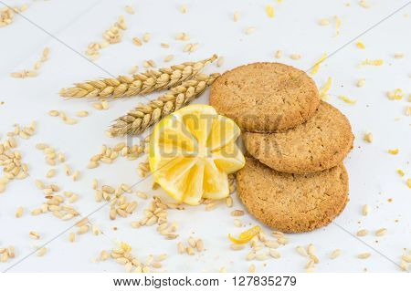 Integral Biscuits With Lemon On White Background