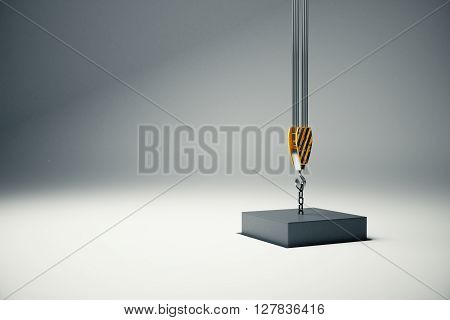Black block suspended on crane hook going into hole. 3D Rendering