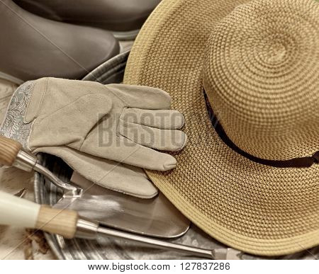 Gardening Attire With Trowel And Straw Sun Hat