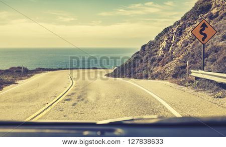 Old Film Stylized Road Seen Through Windshield Of A Moving Car.