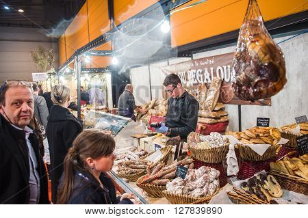 People Buying From Butcher Products At Covered Market