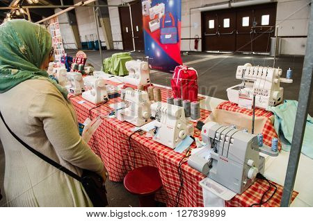 Muslim Woman Looking At Sewing Machines