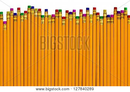Top down view on row of yellow pencils with colorful eraser tops at different heights as concept for eliminating various mistakes
