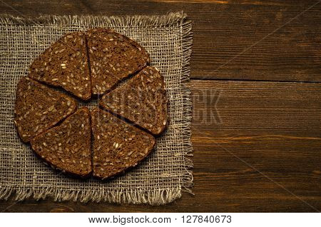 Bread Placed On A Wooden Slope In The Background .