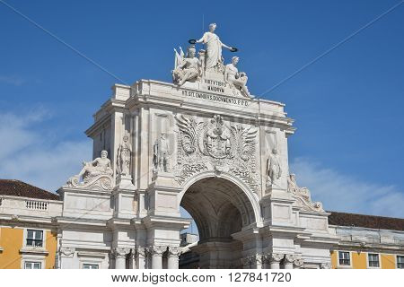 Arco do Rua Augusta, a monumental Arch in Praca do Comercio square with Portugal emblem