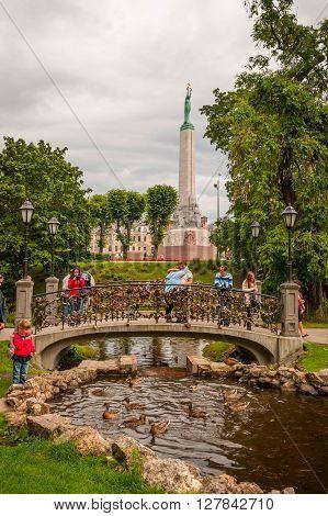 People On The Bridge With Padlocks, Riga, Latvia