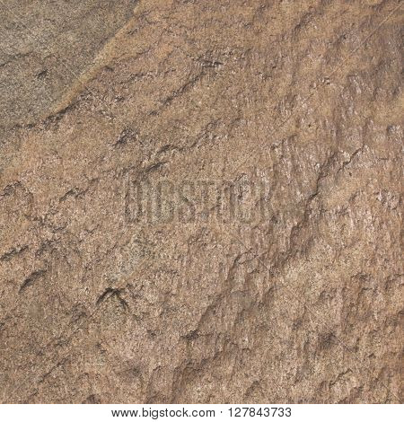 Yellow rough stone texture close up square background