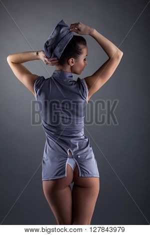 Back view of attractive girl in sexy suit stewardess