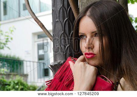 Fashion shoot woman portrait with red handbag
