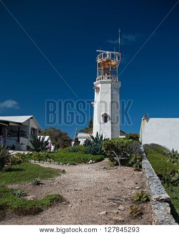 Lighthouse on the small Mexican island of Isla Mujeres (island of the women) at the south point (Punta Sur) called Acantilado del Amanecer (Cliff of the Dawn) which is across the bay from Cancun Mexico