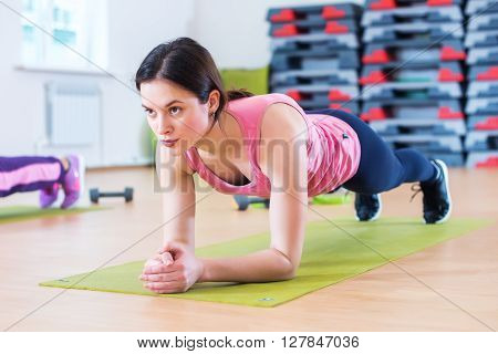 Fit sportive woman doing plank core exercise training back and press muscles concept gym sport sportsman fitness workout strength power