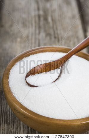 Sugar And Wooden Spoon In A Bowl