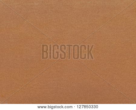 Rough texture of brown sandpaper for design background.