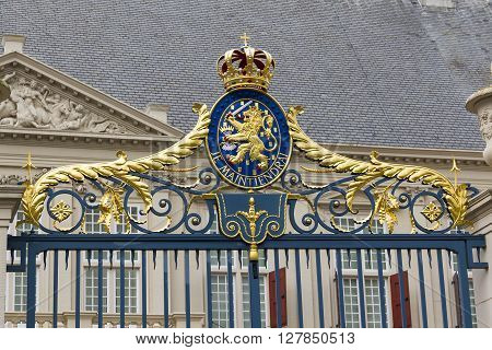 Hague, Netherlands - May 8: This is coat of arms on a gate in the royal residence Palace Noordeinde May 8, 2013 in Hague, Netherlads.