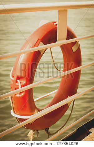 Lifebuoy on board. Close-up view. Retro toned image.