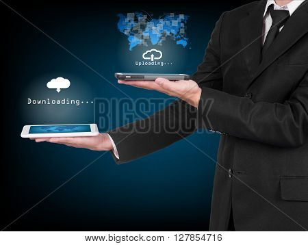 Businessman With Modern Mobile Phone Uploading Data In His Hand