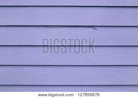 Purple wood texture for the design background.