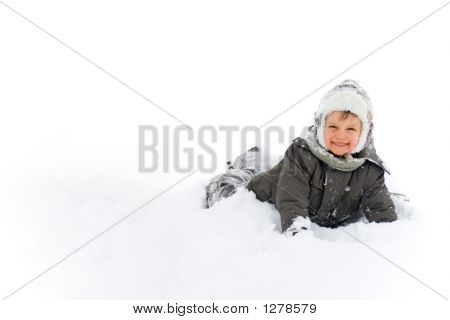 Boy Happily Playing In The Snow