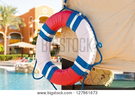 Lifebuoy on the wall. pool background. Security at the hotel