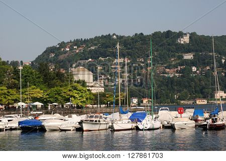 boats on lake Como in Como town with Volta Temple in the background Italy