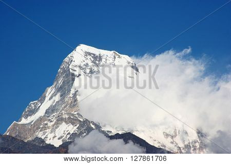 snow-cap Annapurna peak with whirling clouds nepal