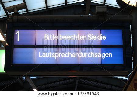 KOETHEN GERMANY - CIRCA APRIL 2016: Bitte beachten Sie die Lautsprecherdurchsagen (meaning: Please refer to the speaker announcement) - digital display in a train station in Germany