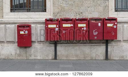 SIENA ITALY - CIRCA APRIL 2016: row of letter box mailboxes for sending mail