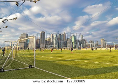 New York City, USA - January 02, 2016: Sunday soccer in the Brooklyn Bridge Park.