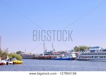 River with cutters to passenger ships and motor boats on summer day