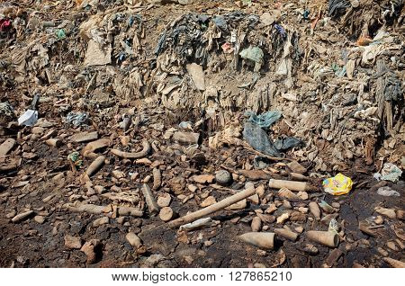 Household plastic waste and industrial garbage contaminates land and groundwater at Bali's largest landfill site in Suwung Bali Indonesia. The site is vulnerable to leachate infiltration and tidal invasion.