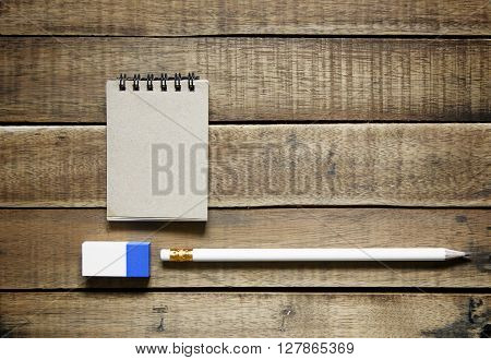 pencil and notepaper on wood stationery office equipment on wooden background.
