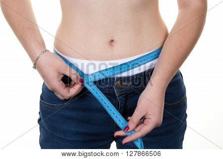 Woman Measuring Her Waist After Loosing Weight