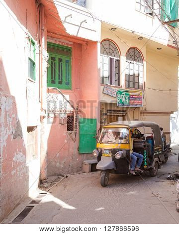 UDAIPUR INDIA - 20TH MARCH 2016: Streets and Tuk Tuks in Udaipur during the day. People can be seen.