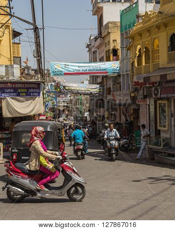 UDAIPUR INDIA - 21ST MARCH 2016: A view along streets in Udaipur during the day. People can be seen.