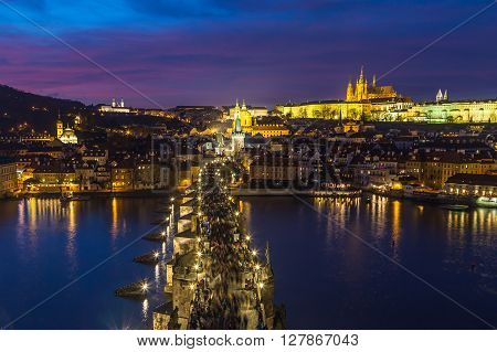 PRAGUE CZECH REPUBLIC - 5TH DECEMBER 2015: A view of the Prague Skyline at dusk from Old Town to the Lesser Quarter. Part of Prague Bridge can be seen.