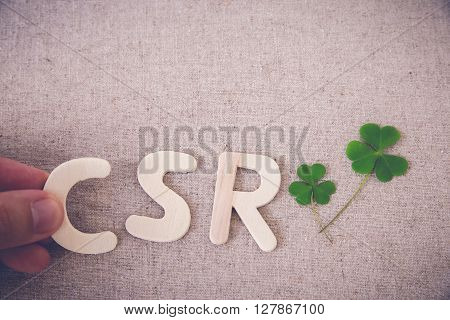 CSR with green leaf copy space background toning